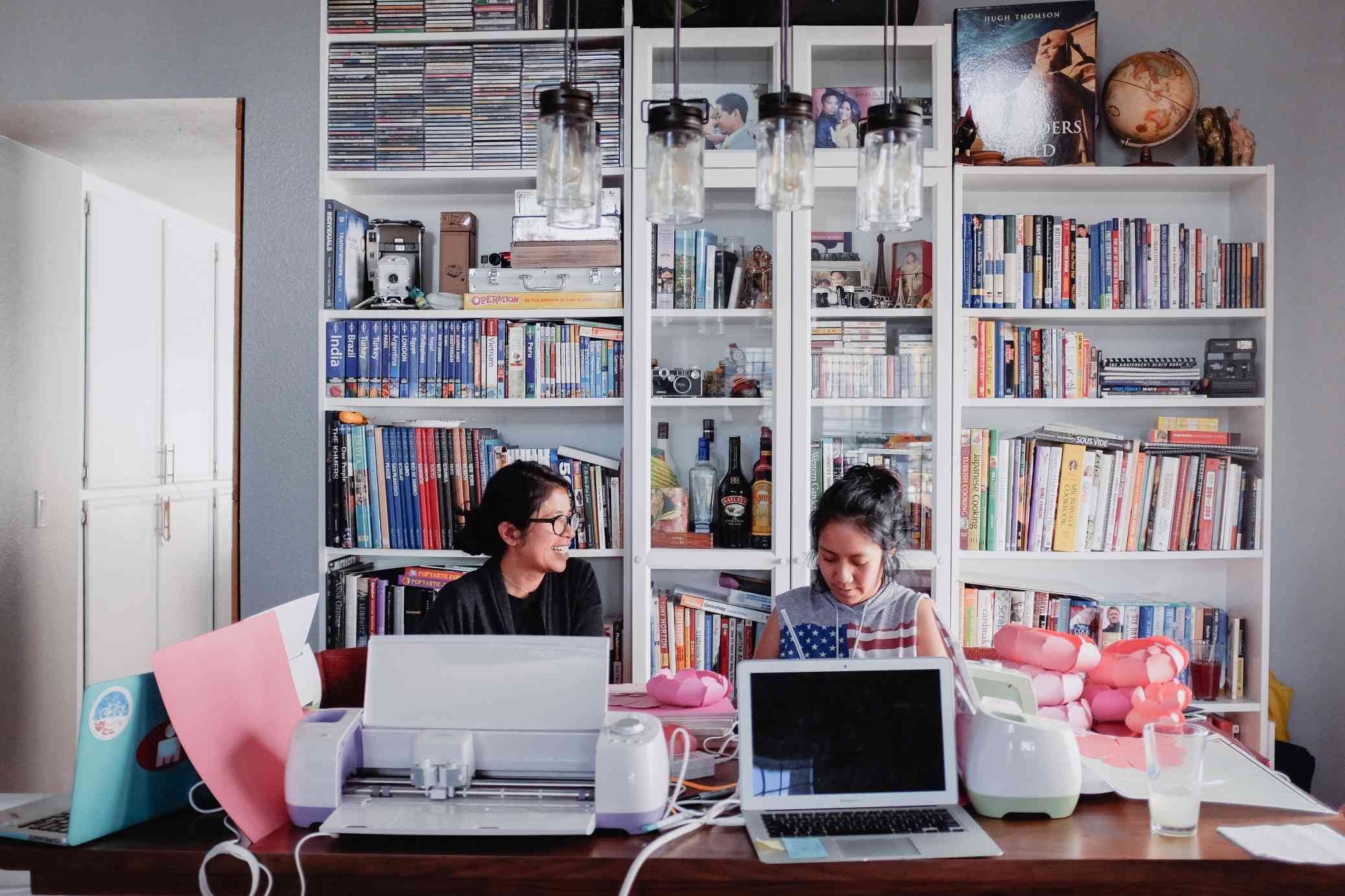 Two women working in a home office.