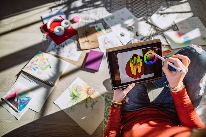 Young Female Artist Making New Designs on a Tablet