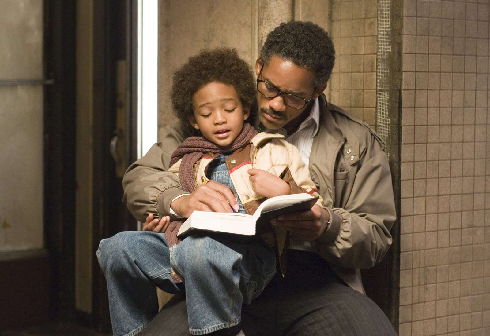 Father and son reading in The Pursuit of Happyness