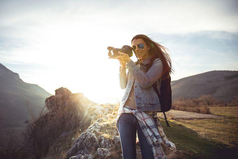 Woman looking through camera