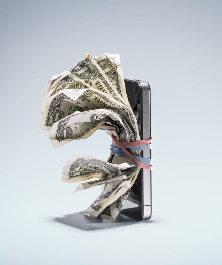 Dollar bills attached to a smartphone