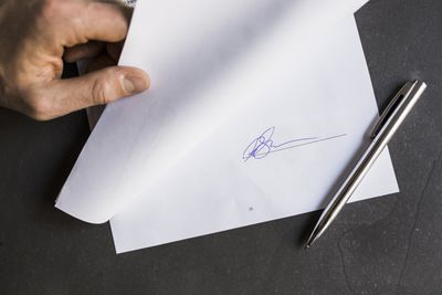 Businessperson holding a document with a signature