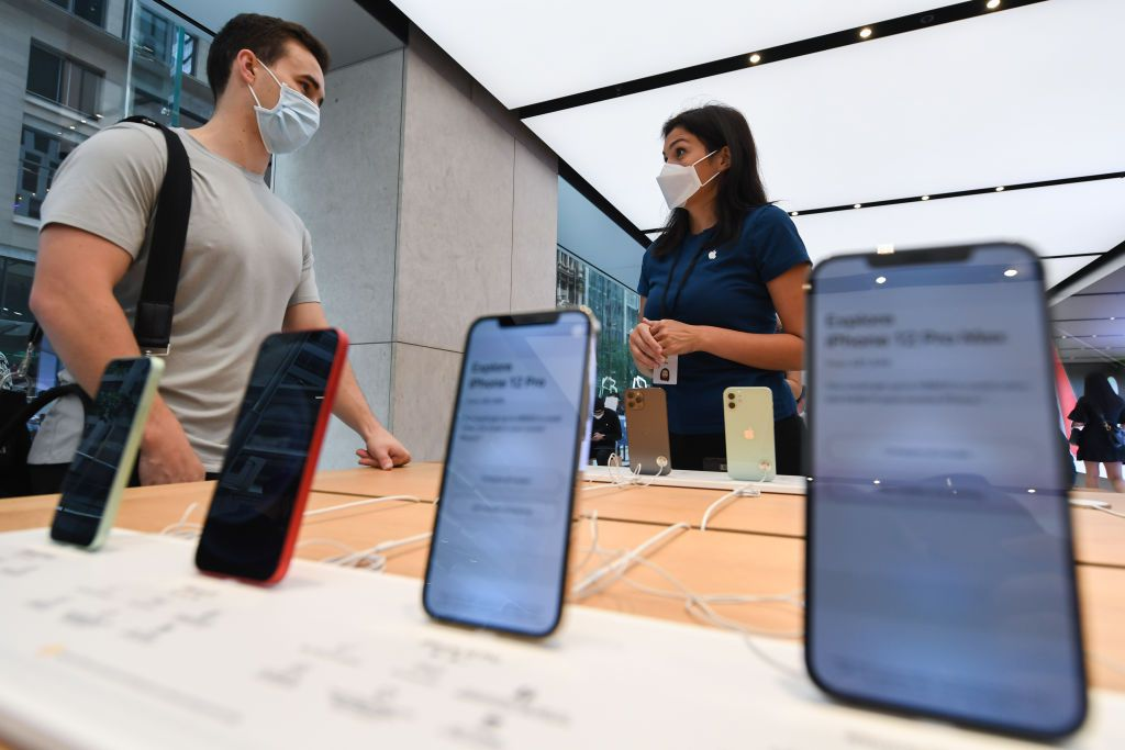 Customers looking at the new products on sale inside the Apple Store on George Street on November 13, 2020 in Sydney, Australia