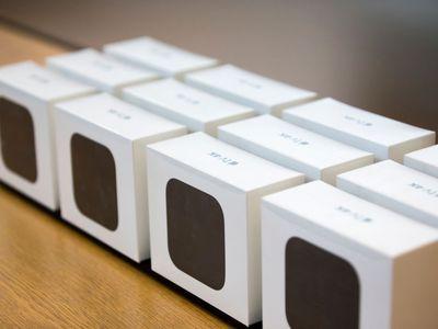 12 Apple TV 4Ks in boxes