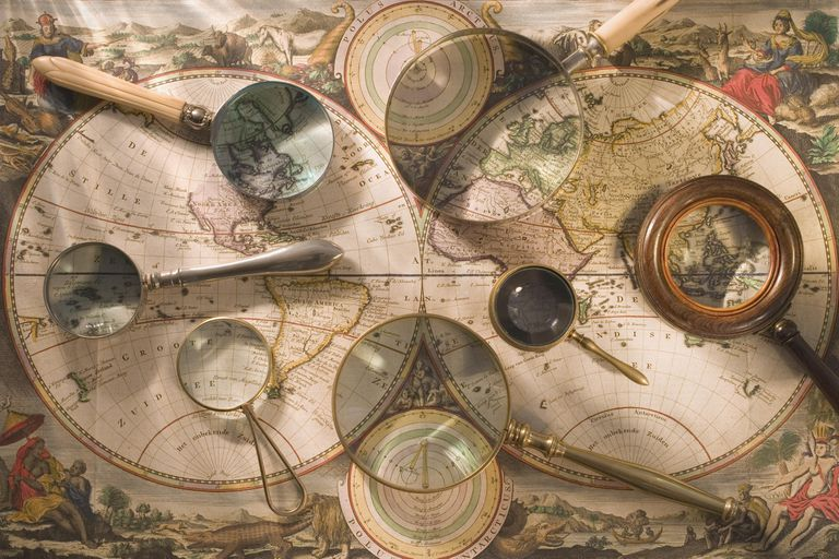Still life of old map with magnifying glasses