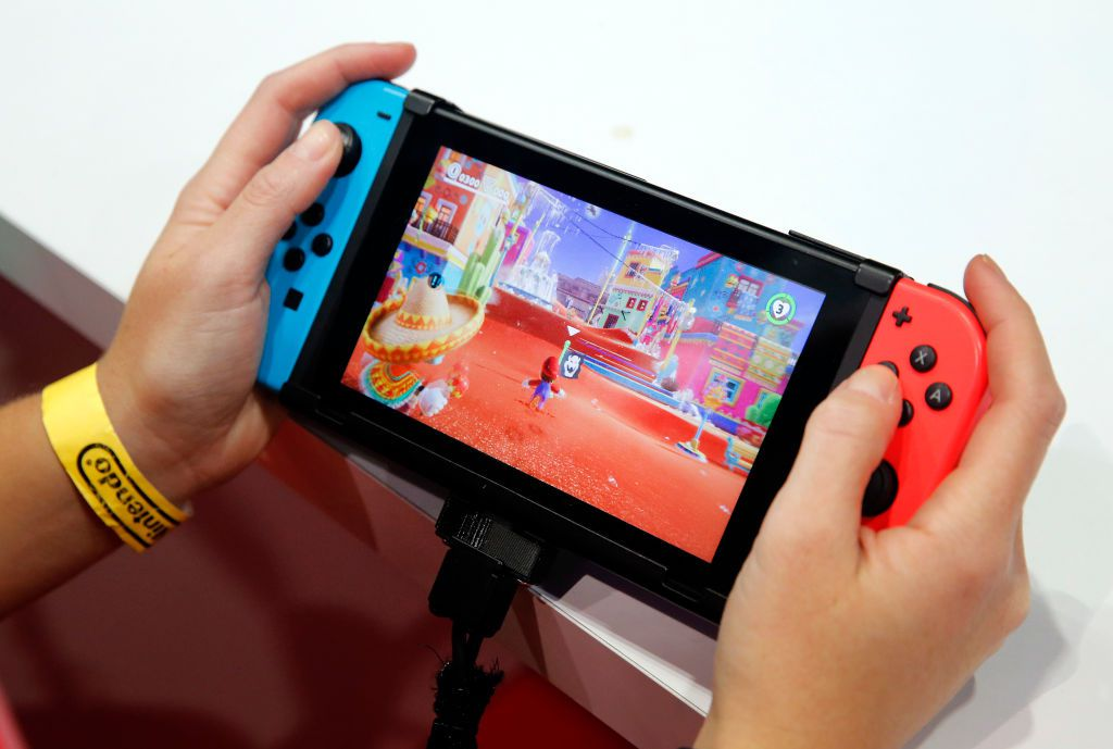 A gamer plays the video game 'Super Mario Odyssey' developed and published by Nintendo on a Nintendo Switch games console during the 'Paris Games Week' on October 31, 2017 in Paris, France.