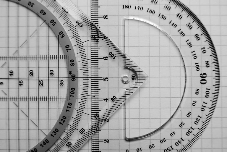 A measuring square and protractor on graph paper.