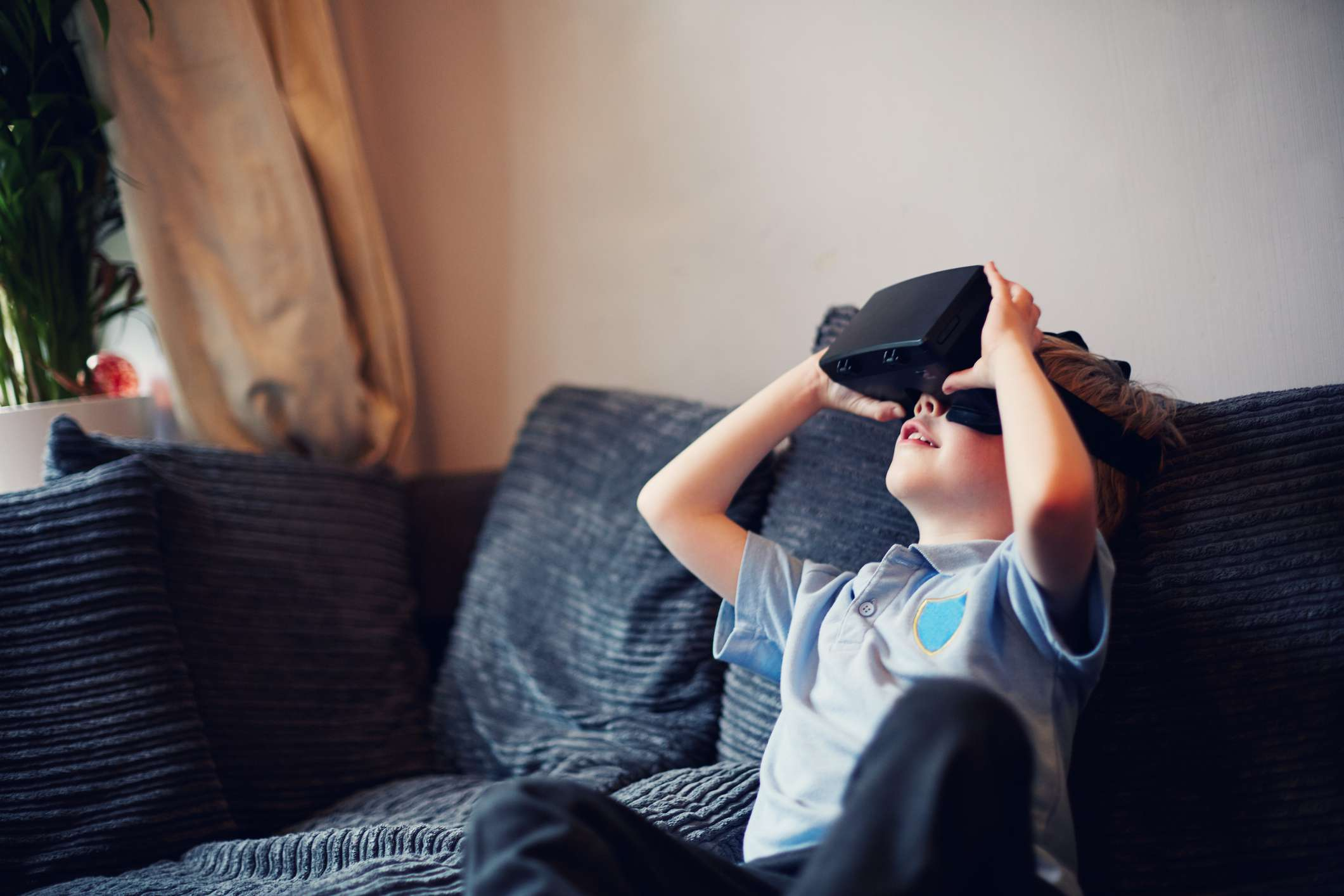 Child wearing VR headset