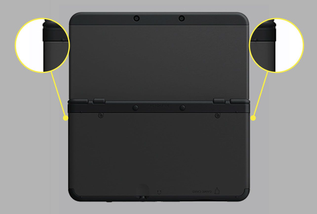 A New Nintendo 3DS XL with the pry spots highlighted