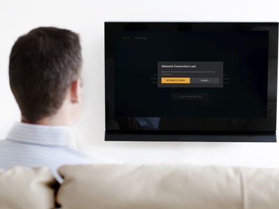 A man looks at a Fire Stick network connection error on his TV.