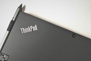 A photo of a Lenovo ThinkPad with logo and camera visible
