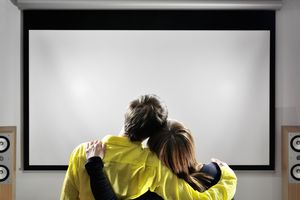 A couple looking at a projector screen