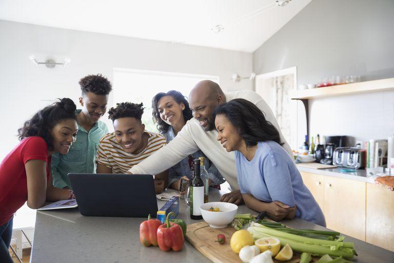 family gathered around laptop