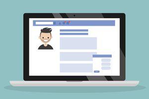 A Facebook profile on a laptop.