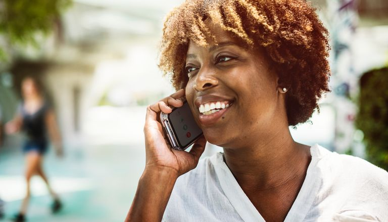 Woman talking on mobile phone outside