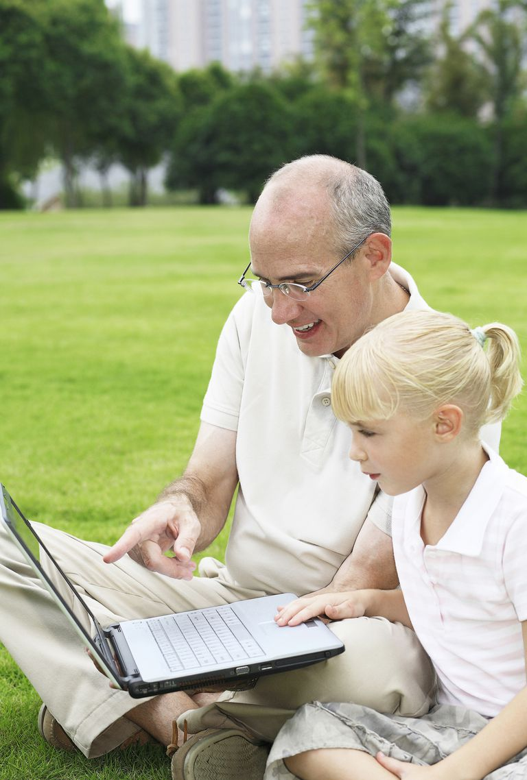 Father and daughter surfing the internet