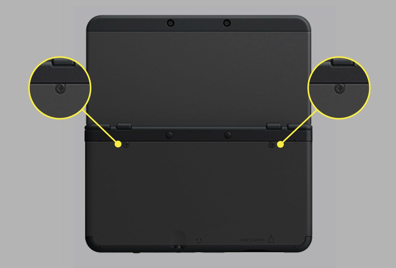 A New Nintendo 3DS XL with the screws on the back case highlighted