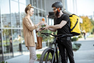 A gig economy worker delivering food to a customer.