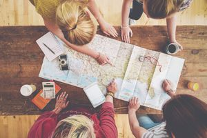 An image of people using a map to plan a trip.