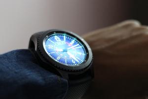 A photo of a man wearing a Samsung Gear S3