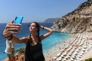 Girl recording a video on phone at beach