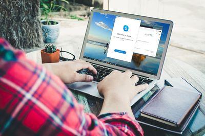 A man installs Skype on a laptop.