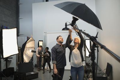 Photographers adjusting lighting