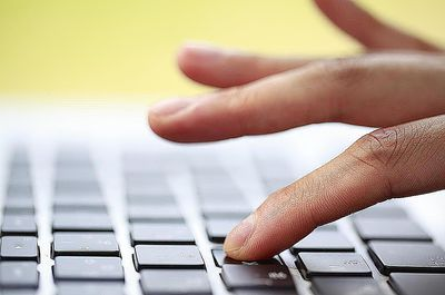 Typing on the keyboard of the PC