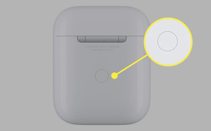 An AirPods case with the pairing button highlighted