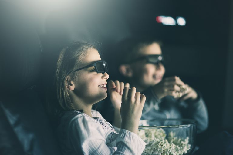 Boy and girl watching 3D movie