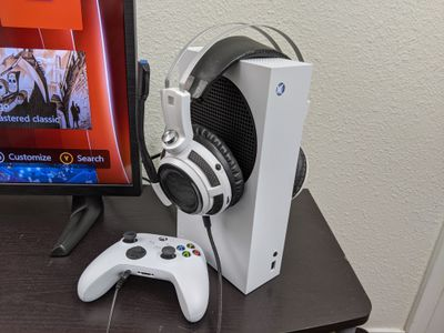 An Xbox Series S with a controller and headset.
