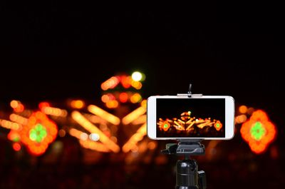 Image of iPhone recording a video of fireworks on a tripod mount