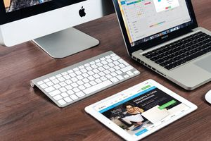 MacBook, iMac, and iPad on desk