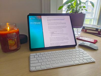 An iPad Pro connected to a Magic Keyboard with Touch ID