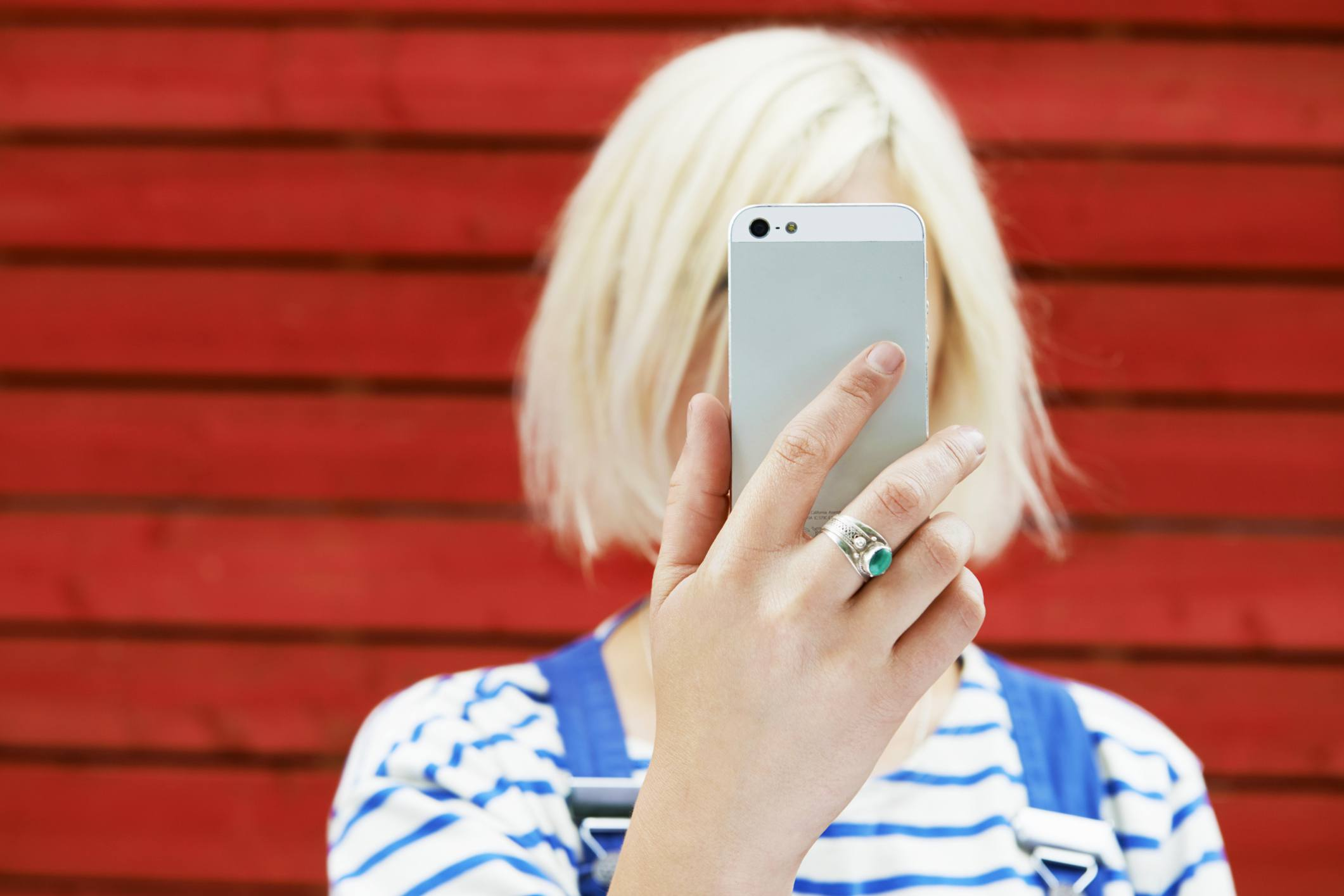 Woman holding cell phone up to her face