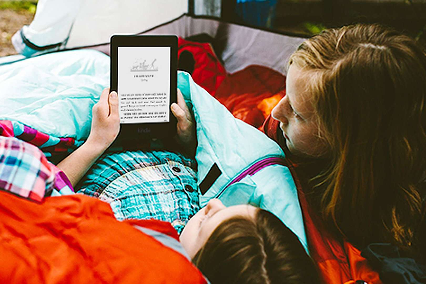 Campers reading on a Kindle Paperwhite 2015