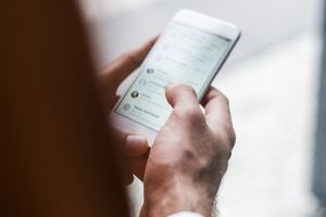 A person messaging on their smartphone