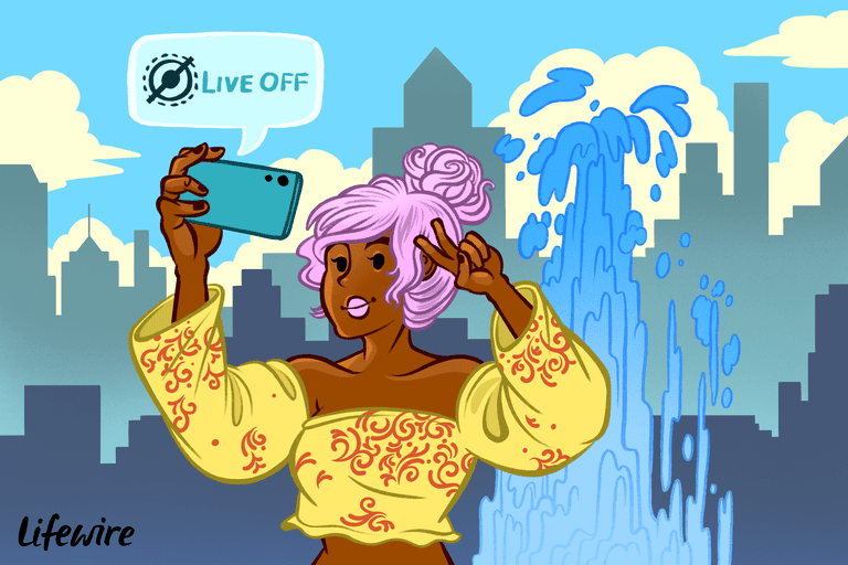 Someone taking a selfie in front of a fountain; Live Off message is on the screen