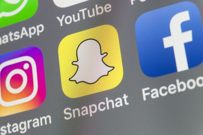 An image of the Snapchat app icon on an iPhone screen.