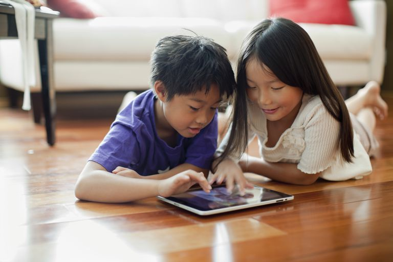 2 Children using tablet