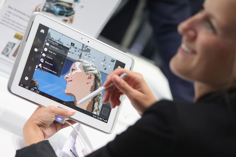 Woman using Samsung Galaxy Note 10.1 tablet
