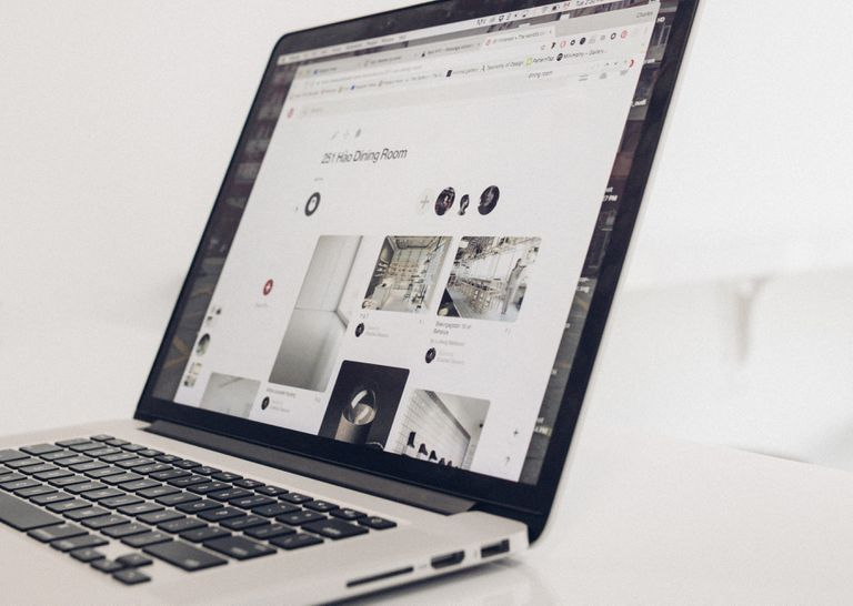 Black and white image of laptop with Pinterest on the screen
