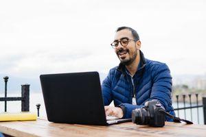 Man blogging outside