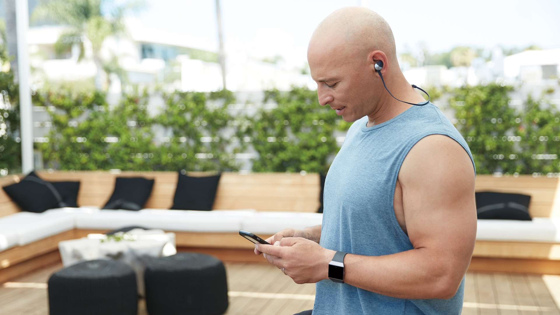 An exercise enthusiast syncing their Fitbit fitness tracker.