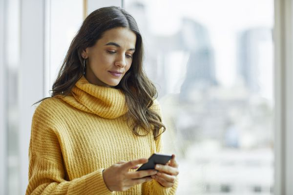 A woman using a smart phone.