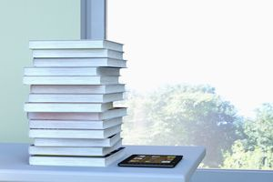 E-reader and stack of books lying on a table in front of a window, 3D Rendering