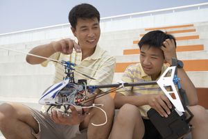 Father and son playing with RC helicopter