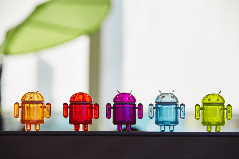 Photo of a row of plastic Android figurines in different colors