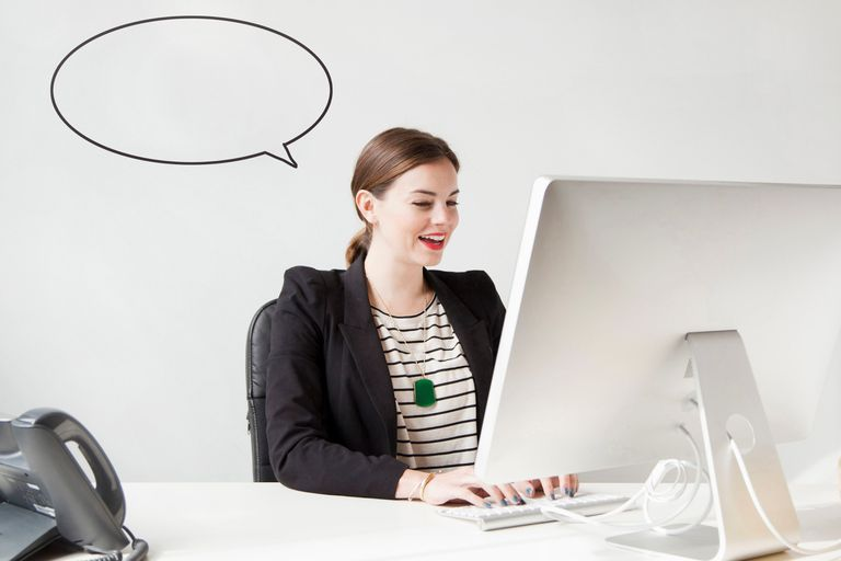 woman on computer with text bubble