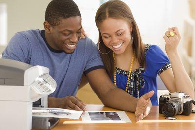 A couple admires a printed photo.